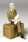 O Scale Sitting Man in Suit Reading Newspaper