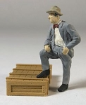 O Scale Man in Suit with Foot Up