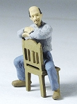 O Scale Man sitting backward on chair