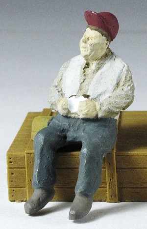 O Scale Sitting Worker with Sandwich